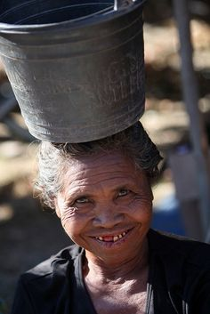 Oecussi Woman. Kefua village, Oecussi-Ambeno. *East Timor is located in the eastern part of Timor, an island in the Indonesian archipelago that lies between the South China Sea and the Indian Ocean.