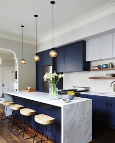 The matte finish of the cabinetry in this modern kitchen - coupled with the navy palette and the elegant marble counters - complete its contemporary aesthetic that is simply drool-worthy!  #interiordesgin #roomdecorideas #luxurybrands