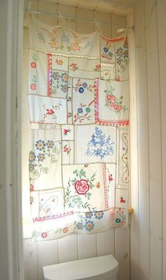 Hankie window treatment- I absolutely LOVE this! Now.......which room could I have a hankie curtain!
