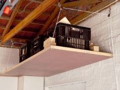 A smarter way to store the bulky things that you only need occasional access to: a pulley system in your garage or shed. Ceiling Bed, Ceiling Storage, Bedroom Ceiling, Attic Storage, Garage Organization, Garage Storage, Pully System, Tiny Studio, Tiny Spaces
