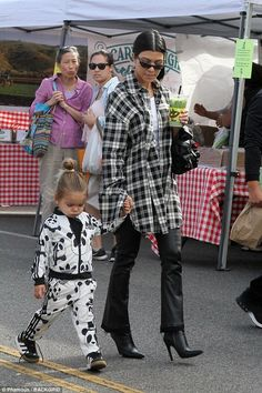Keeping a close eye: The 38-year-old star held hands with her adorable toddler while rock...