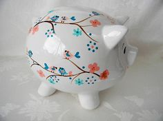 Delicate branches with perky little birds and flowers in soft colors make this the perfect piggy bank for that special someone!