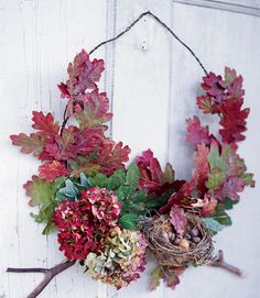 This fall wreath can be adapted for a variety of leaves and blooms. Use dried white oak leaves, fresh hydrangea, and small branches. Materials required: barbed wire, floral wire or tape, wire cutter. A glue gun is also a good tool to have on hand.