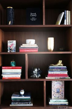 Vintage books curated by Thomas Cary and decorative objects by Kelly Wearstler, AERIN, Kathryn McCoy, and L'Objet