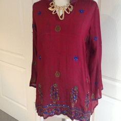 Maroon Indian tunic Worn once or twice. Would fit a medium perfectly! In good condition - like sheer but not see through, would be cute to party or over bathing suit! My sister is a large and it fits her also. Can post measurements if needed dolls  Tops Tunics