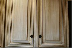 YES! Detailed blog on taking oak cabinets to an antiqued white using Rust-o-leum Cabinet transformations. Seems the lighter colors still show the wood grain.