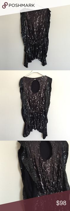 Free people black sequin butterfly tank small Gorgeous tank! Pictures don't do it justice. Beautiful condition. Worn one time. Keyhole cutout in the back with boat neck front. Side panels with fluttery wings on front and back and elastic waist. Drapes the body so well! Bundle to save 25%! Free People Tops Blouses