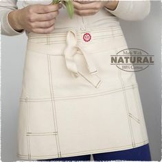The perfect thing to protect your clothes is this American Made artist's apron.  It sports an assorted size of pockets to keep your tools and small supplies handy!  Find it at Raw Materials Design of Seattle Washington.