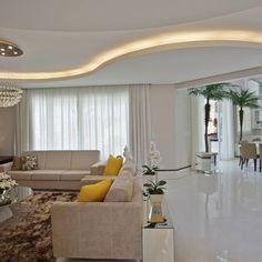 Essa seria a sala de estar maravilhosa! Duas almofadas amarelas foram o suficiente para abrir a cor da sala, trazendo mais vida n...