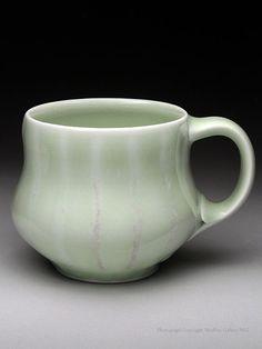 "Allya MacDonald | Wheel-thrown & altered porcelain mug with celadon glaze finish. (3.5x5x3.5"")."
