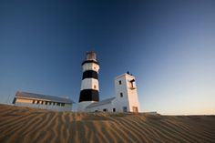 Photo about A photograph of a lighthouse at Cape Recife, Port Elizabeth, South Africa at sunrise. Image of sunrise, daybreak, pattern - 9542929 Port Elizabeth, Lighthouses, Cn Tower, South Africa, Cape, Things To Do, Sunrise, Ocean, Building