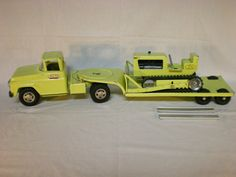 Tonka Tractor Lowboy Trailer and No.100 Bulldozer 1960 Vintage Toy Construction Truck Lime Green via Etsy $150.00