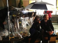 Ep513 Stana Katic and Jack Coleman share an umbrella while providing an off camera eyeline for the other actors
