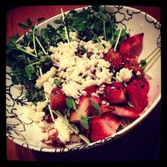 Yummy rabbit food - pea shoot salad with  strawberries, feta goat cheese and balsamic vinegar reduction