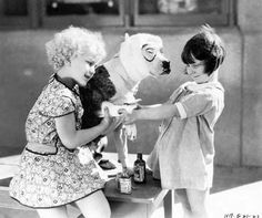 Our Gang kids Jean Darling and Mary Ann Jackson give Pete some first aid.