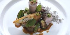 Loin of rabbit with rabbit spring roll and tomato couscous
