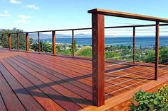 When it's all about the view, consider using cable rail (instead of vertical balusters) threaded horizontally between vertical hardwood posts. Check local building codes for spacing. | via Feeney, Inc