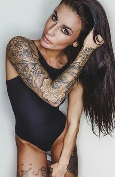 I like this picture of this woman, the tattoos, hair, black 1 piece , eyebrows, skin tone, just beautiful !!!!