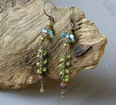 Hey, I found this really awesome Etsy listing at https://www.etsy.com/au/listing/263944783/green-tribal-earrings-long-crystal