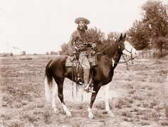 Mounted on his paint horse in a Colorado field, the scout and artist Charles Stobie.