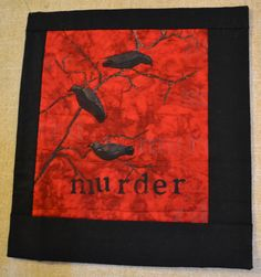 The Challenge was  groups....Did you know a group of crows is called a murder of crows?  Acrylic paint stenciled on fabric, some with matt medium, some with gloss.  Thread painted branches.  The word is also stenciled in just medium and thread.