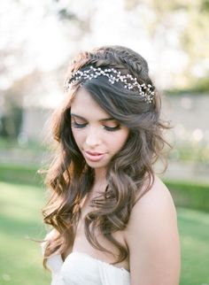 Braided half up half down wedding hairstyle with vine