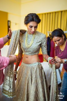 Sangeet Lehengas - Bride Getting Ready in a Dull Gold Lehenga with a Sequinned Blouse and a Gold Necklace | WedMeGood #indianbride #indianwedding #lehenga #gold #bridal