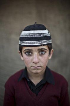 Hayat Khan, age 8.   21 Powerful Portraits Of Afghan Refugee Children