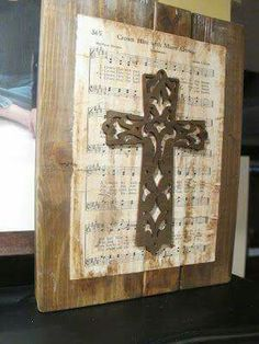 Use barn wood and old hymn page