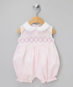 Take a look at this Pink Flower Smocked Romper - Infant by Classy Couture on #zulily today!