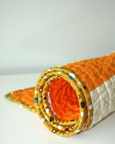 graphic modern baby quilt - Orange Creamsicle. via bperrino's etsy shop.  Nice way to photograph binding detail of a quilt.