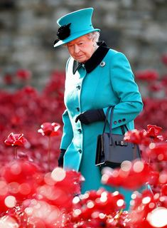 Queen Elizabeth II visits the Blood Swept Lands and Seas of Red evolving art installation at the Tower of London on October 16, 2014 in London, England. 888,246 poppies will be planted in the moat by volunteers with the last poppy being planted on the 11th November 2014. Each poppy represents a British or Colonial fatality in the First World War. The poppies are for sale with 10% plus all net proceeds going to six service charities.