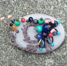 Handmade brooch and necklace with natural colored stones and  beads by BLACKSHEEPby on Etsy
