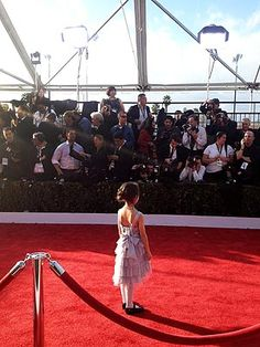 SAG Awards: Aubrey Anderson-Emmons strikes a pose : People.com. I find this picture incredible. A perfect moment for a photographer to capture a 5 year old girl who poses so quietly and still before a group of flashing photographers, seemingly unaware of the noise and craziness.
