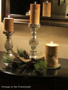 Mercury glass, pine cones, antlers & candles, lovely