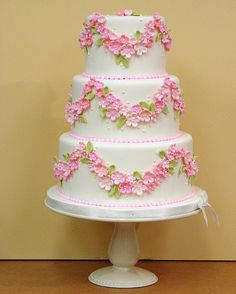 Just so pretty! Ivory cake adorn with sweet pink flowers!