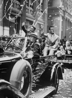 Wiley Post and Harold Gatty during ticker tape parade which celebrates their 'round-the-world flight.'  Copyright 1999 by Daily News LP. For...