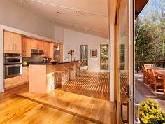 Blu Glidehouse with maple cabinetry, Caesarstone countertop in Concrete.