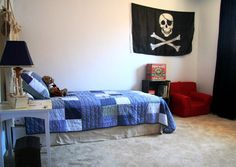 Small Bedroom With Walls Of The Room Are White And Wall Decorations In The Form Of Black Flag Skull Picture