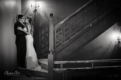 Moody black and white bridal portrait in the stairwell of the Hotel Fort Garry in Winnipeg.