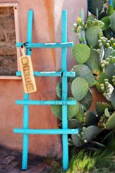 Colorful turquoise, wooden ladder catches the eye of visitors to