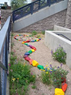 Painted rocks are eye catching in a xeriscaped space (this one is in Scottsdale, AZ) and painting the stones is an easy, fun project for kids.