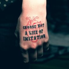 """choose not a life of imitation"" human heart, hand tattoo."