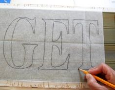 how to make a wooden sign, need to buy some tracing paper.
