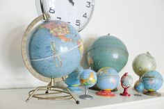 """Globes, globes, globes....  I like this display which uses different sizes, but all generally """"blue."""""""