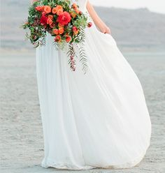 Coral, orange, red, green and mint colored flower arrangement (for bridesmaids)