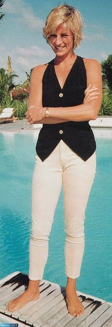 Diana in St. Tropez. Love this, so chic. so now. White jeans and black sleeveless vest.