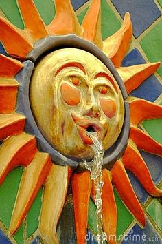 Colorful sun face fountain by Aron Hsiao, via Dreamstime