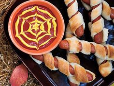 Mummy Dogs | These make-ahead hot dogs use refrigerated breadstick dough, perfect for goblins, pretty princesses, superheroes, and even their parents. Watch the how-to video at SouthernLiving.com.