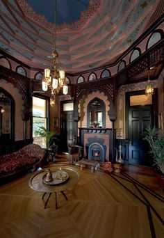 """The Turkish Parlor of the McDonald Mansion, conceived in the Moorish Revival-style.  At the center of the dome, the flat, deep blue """"night sky"""" oculus crowns a Persian-inspired Bradbury wallpaper ensemble, and is the only visible surface that exposes the full height of the room's sixteen-foot ceiling. #bradburywallpaper"""